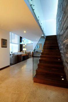 Pasillos, vestíbulos y escaleras de estilo translation missing: ar.style.pasillos-vestíbulos-y-escaleras.moderno por ze|arquitectura