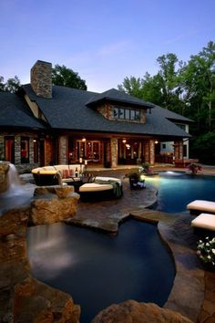 Gorgeous for a lake house love the stone pool make the inside a type of stone also so the dog can come in!