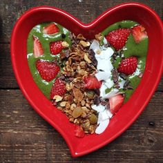 I bet this is the greenest @heartbowl breakfast you've seen today: organic spinach, @moremoringa magic leaf powder, @organicburst wheatgrass, frozen banana, chia, flax, coconut mylk. Topped with coconut, organic strawberries, #granola, cacao nibs ❤️ Counting down the days till I'm in CA!  #breakfastcriminals #heartbowl