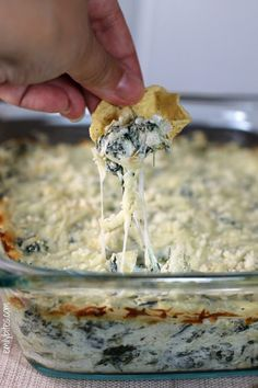 This lighter Spinach and Artichoke Dip has all the creamy cheesy goodness of the original, with less calories! Only 115 calories or 3 Weight Watchers points per serving. www.emilybites.com #healthy