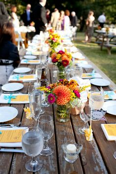 Gorgeous flowers and table settings - fall colored dalias (orange, yellow, red)