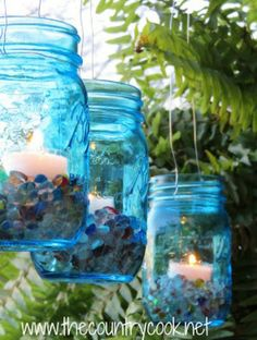 Hang mason jars outside for a magical DIY candle holder.