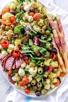 Making a salad for a crowd doesnt get any easier than adding all the antipasto toppings like olives pickled veggies artichokes pepperoncini salami salumi prosciutto pasta and mozzarella balls to. Antipasto Recipes, Antipasto Platter, Pasta Salad Recipes, Appetizer Recipes, Snack Platter, Crowd Appetizers, Recipes Dinner, Soup Recipes, Salad Bar