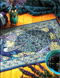 Beautiful Buduoir Peacock Rug or Wall Hanging In Cross Stitch or Needlepoint Pattern. $4.99, via Etsy.