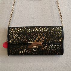 """Black and gold clutch/crossbody Brand new never used. Really cute. I bought this and realized I have 3 other bags with the same colors. I love black and gold bags hehe. Measures 5""""x10"""" with a long tuckable strap Bags Crossbody Bags"""