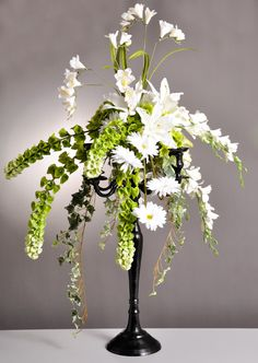 Classy centerpiece in a black candelabra, available by special order from Pioneer Wholesale Co. Design by Tom Bowling, AIFD, PFCI