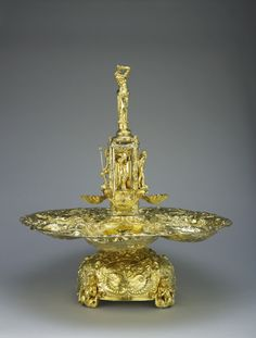 """The Plymouth Fountain England, mid-17th century The Royal Collection """"A silver-gilt Baroque fountain with four spreading basins, repousse and chased with marine figures, surmounted by a square column with figures in niches on each side, the finial..."""