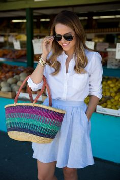 Blogger Gal Meets Glam explores a local fruit stand in a crisp Gap oxford.
