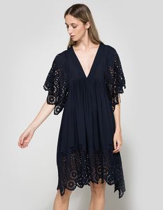 From Ganni, a lightweight dress in Iris. Featuring a deep V-neckline, three-quarter sleeves, broderi anglaise details, partially lined, scalloped hem and a casual fit.  • Dress in Iris • Deep V-neckline • Three-quarter sleeves • Broderi Anglaise deta
