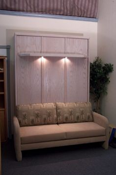 Awesome Lighted Maple Wood Murphy Bed With Cream Velvet Love Seat Sofa As  Well As Wall