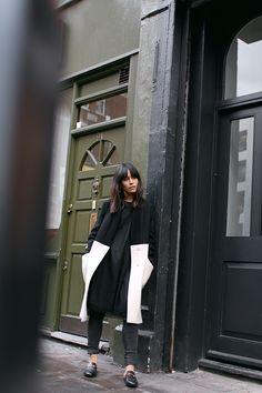 Nisi is wearing: Gucci Princetown slipper, Üterque two-tone coat, black mesh dress, skinny jeans - teetharejade.com