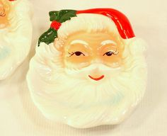 Vintage 1950s Santa Ashtrays Wall Plaques by Vintiquesandmore ~Wall décor or ashtray, your choice!  Yep Santa here is a smoker.  Just smash your butts on his face, or rest the burning cig in the beard channel.  Who knew, right?