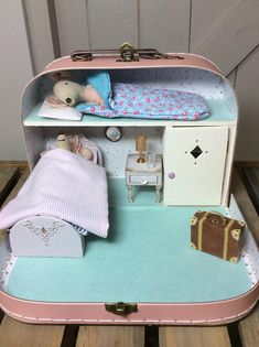 Sleepover at Mouse Cottage. Featuring Maileg Big Sister in her cosy mouse bedroom in a pretty pink suitcase.
