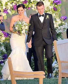Easy does it: Nick chose a simple black tux and bow-tie for his big day