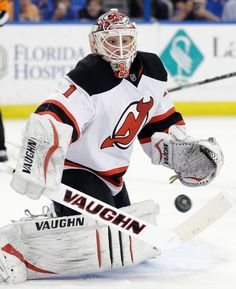 New Jersey Devils goalie Keith Kinkaid makes a save on a shot by the Tampa Bay Lightning during the second period of an NHL hockey game Thursday, April 9, 2015, in Tampa, Fla. (AP Photo/Chris O'Meara)