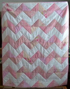 This is a little quilt I made for my newest grandbaby and I promised a tutorial for all of you.   Materials required:  50 pink charm squares...