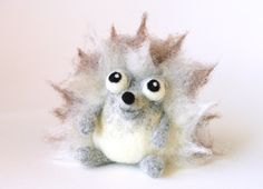 Dominique the Hedgehog / needle felted art toy. via Etsy.