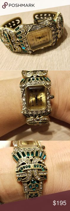 Heidi Daus ladies watch Hinged bangle style watch, antique gold finish encrusted with green and clear crystal jewels. Gently worn only a couple times. Equipped with brand new watch battery. Very elegant, perfect gift for the holidays! No box. Heidi Daus Jewelry