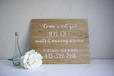Small hand painted business sign on natural / light stained plywood. Custom store front signage.