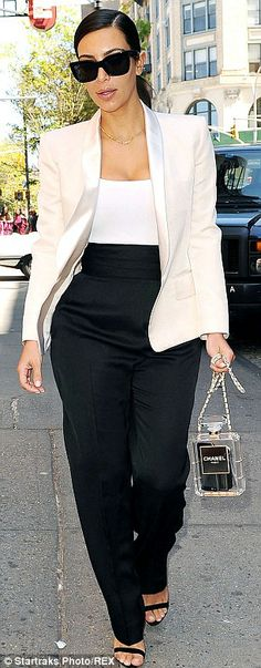 Style for days! Just 10 months after welcoming her first child, the star is looking trim, toned and terrific, perfectly displaying her physique in black loose-fit pants, a tight white top, thick black satin belt worn high across her midsection and smart white black blazer, paired with strappy black stilettos