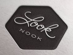 LookNook logo. Designer: Brian Simpson. Liked the contrast between the pretty script and plain sans serif. #identity