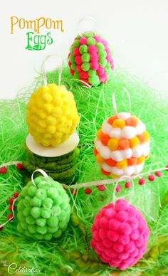 Turn white, plastic eggs into bright and whimsical PomPom Eggs! Ready-made pompoms and a hot glue gun make it easy to create fuzzy, colorful eggs to decorate th