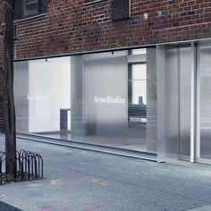 Sophie Hicks sets Acne Studios' flagship identity in the concrete jungle - News - Frameweb Architecture Windows, Interior Architecture, Commercial Architecture, Acne Studios Store, Retail Facade, Retail Signage, Into The West, Retail Interior, Facade Design