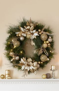 """This season add some glitz and gold to your holiday décor with this 34"""" wreath. Its color palette of gold and cream will light up any room, especially when accentuated by the 50 battery-operated LED lights. Available online only, so order it now to ensure a brilliant holiday accessory."""