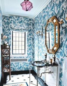 {I adore the bold, #Bohemian quality of this powder room. I would choose different light fixtures, but the wallpaper, matching drapes, classic sink, tile, and glamorous mirror are perfection. This feels like a little jewelbox.}