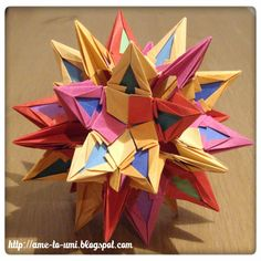 Kusudama Mandragora (fire), origami, designed by Ekaterina Lukasheva. Made from 1:2 strips, 30 pieces, and 60 pieces of contrast color inserts; connection: nothing, folded by me.