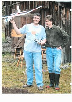 The guy on the right is wearing the old-style black rubber boots with red trim & soles. And what's wrong with that?