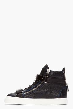GIUSEPPE ZANOTTI - Black and navy croc-embossed leather London high-tops High top leather sneakers in black with navy blue edging at seams throughout. Crocodile skin texture embossed throughout. Round toe. Black lace up closure. Leather logo patch at padded tongue. Silver tone metal bar detail at velcro tabbed eyerow. Extended heel collar with exposed silver tone zipper closure. Silver tone exposed zipper detail at eyerow. Textured rubber foxing in white. Made in Italy. $1075 CAD