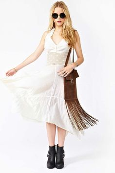 Totally sweet vintage ivory halter dress featuring a crochet waist line and asymmetrical hem.