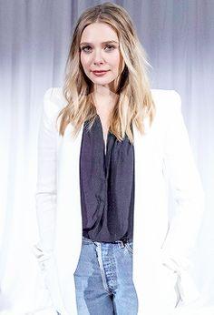 Elizabeth Olsen at Captain America: Civil War Press Conference on April 10, 2016.