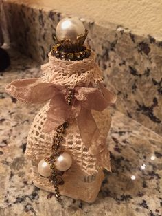 Up-Cycled perfume bottle - for me. January 2016. #decoratedbottle #pearls #lace #upcycled #vintage