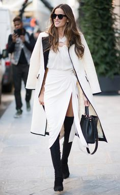 Izabel Goulart from Victoria's Secret Models Off-Duty Style  That sliver of exposed leg helps break up the jarring contrast between white and black to create an exceptionally classy-yet-sultry look.
