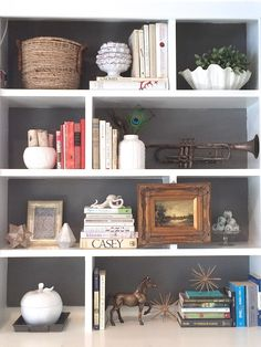 Add pattern, a darker color, or metallic paint inside a bookshelf to add visual interest.