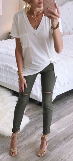 #transition #spring fall #outfits women's white V-neck cap-sleeve shirt and green leggings