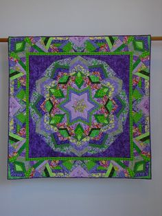 This quilt was made using Ricky Tims Kool Kaleidoscope methodology. And it is featured as one of the example quilts in his book of the same name,