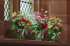 Wild flowers in jam jars decorating church window sills | Photography by http://www.mark-tattersall.co.uk/