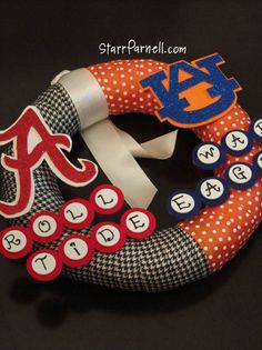 My 1st house divided wreath! Very pleased with how it turned out! Alabama v. Auburn with their logos and phrases