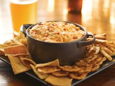 Frank's Red Hot Buffalo Chicken Dip- Preheat oven to 350 degrees. Stir 1 package softened cream cheese in baking dish until smooth. Mix in .5 cup blue cheese salad dressing, .5 cup Frank's Red Hot Buffalo Sauce, .5 cup shredded mozzarella cheese, and 2 cans drained Swanson White Premium Chunk Chicken Breast. Bake for 20 minutes. Serve with Lays Wavy Original Potato Chips or Ruffles Molten Hot Buffalo Wing Potato Chips!
