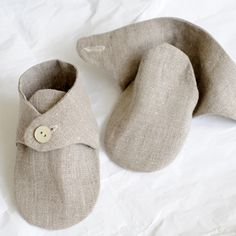Baby shoes, not available, just inspiration.  http://www.ldsmomtomany.blogspot.com/2010/11/todays-booties.html  ,<--Here is a similar pattern but it has gathered elastic across the back to help them stay on.