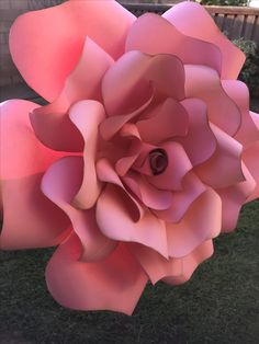 Pink paper flower with gold edging and highlights