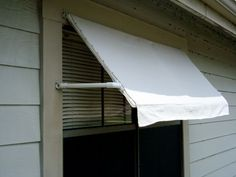 PVC frame and vinyl-backed canvas drop cloth (Home Depot Paint Dept.) to make awning...keep the heat out in summer. I would make the drop cloth for easy removal in winter; maybe eyelets or grommets with lacing.