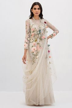 Beautifully crafted Net floral embroidered short shirt highlighted with delicate hand embellishments. Pait it up with tulle skirt and embroidered side drape dupatta for the perfect look. Pakistani Dress Design, Pakistani Outfits, Pakistani Bridal, Indian Bridal, Indian Designer Outfits, Designer Dresses, Designer Wear, Indian Gowns Dresses, Dress Indian Style