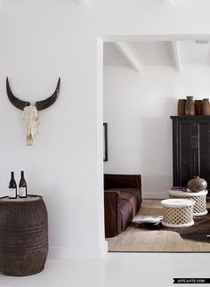 The starkness of the walls allows you to focus on the items in the room. Maison Estate. Franschhoek Valley, South Africa.