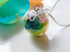 Rainbow Rose Petal Necklace Resin Flower Globe by WishesontheWind, £23.00. Neat idea for petals from wedding bouquet.