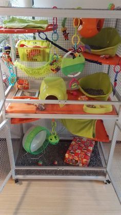 This not only looks adorable but has so many toys and things to do packed in too, wonderful cage!
