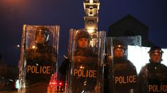 Protesters set Kosovo govt HQ on fire over deal with Serbia  http://pronewsonline.com/pronews-blog  ARCHIVE: Police hold shields during a demonstration by protesters in the centre of Pristina January 24, 2015 © Hazir Reka